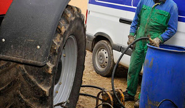 What are the disadvantages of using water ballast in tractor tyres?